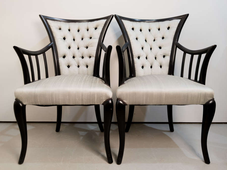 Circa 1928 A Pair of French ebonised chairs
