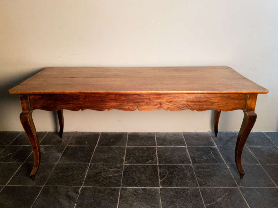 An 18th Century French Fruitwood Refectory Table
