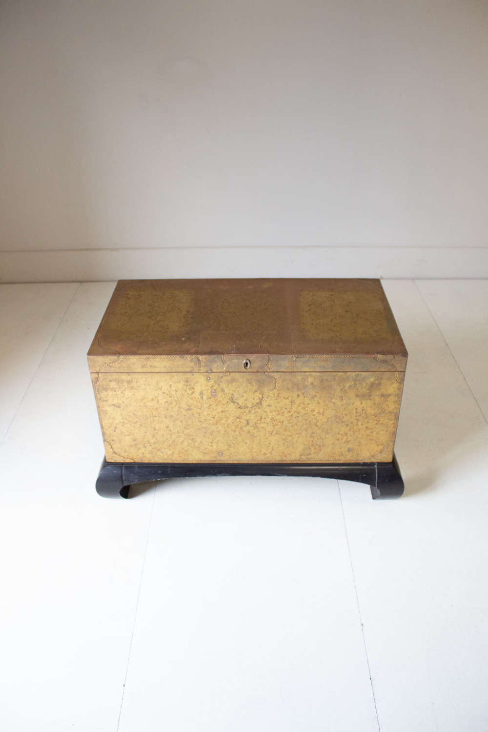 Circa 1960 A Spanish Brass Trunk on Ebonized Base