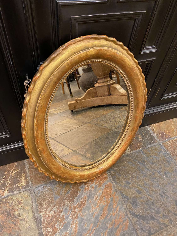 C1880 A Small Oval Gilt Mirror